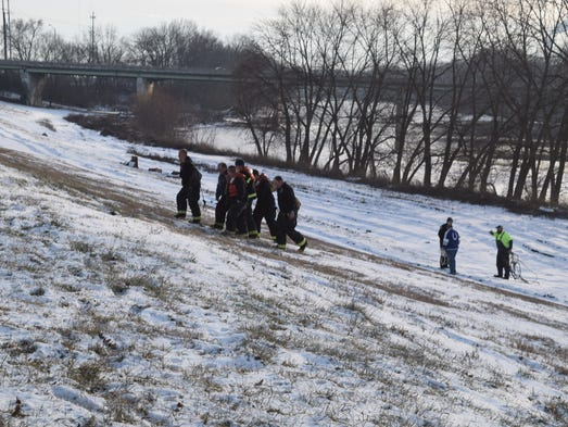 IFD firefighters rescue a man from the White River
