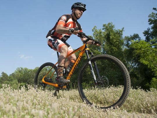Chris Schultz of Yardley, Pa., rides his mountain bikes