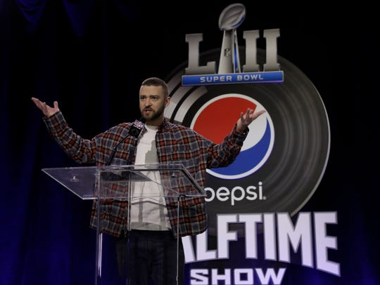 Justin Timberlake answers questions during a news conference