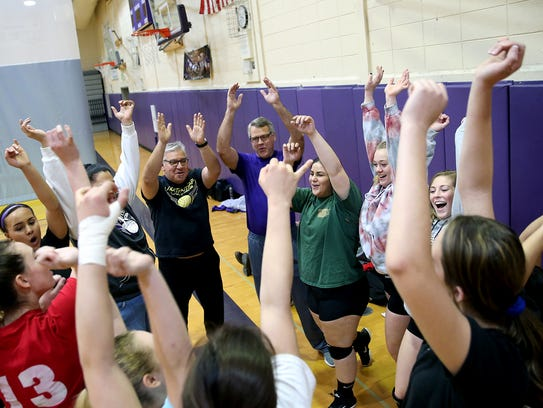 North Kitsap volleyball coach Tim French, center, and the team get ready for the start of practice after each player stated their goals for the session.