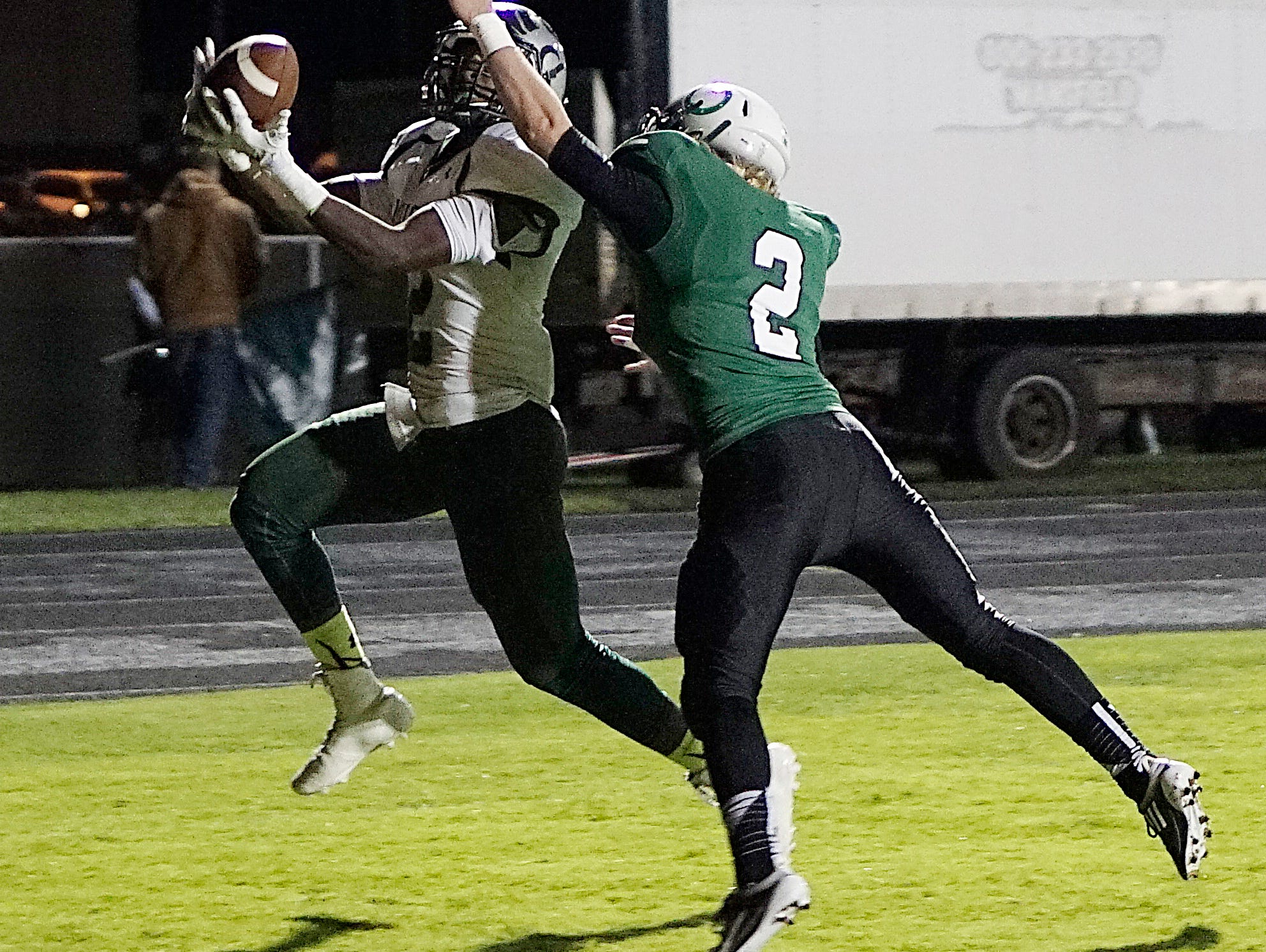 Madison's Tyrell Ajian catches a TD pass during the second quarter of their game against the Colts at Clear Fork High School.
