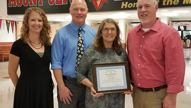 Diane Phares receiving her state finalist certificate. Pictured (left to right) are: VP Susan Pasquelone, Principal Kevin Stansberry, Diane Phares and VP James Kramer.