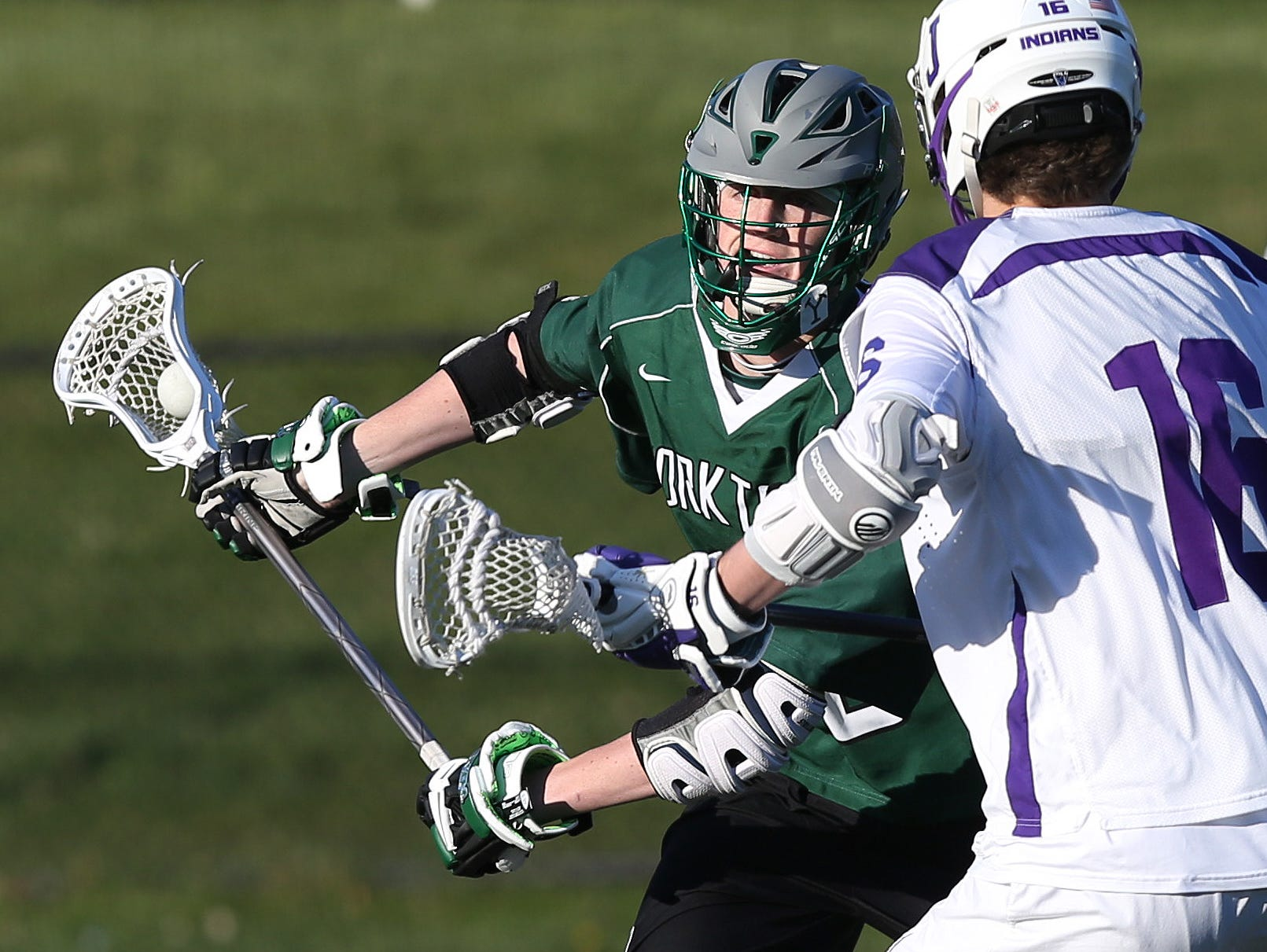 Yorktown's Kyle Casey (15) tries to get around John Jay's William Slater (16) during a boys lacrosse game at John Jay High School in Cross River April 14, 2016. Yorktown won the game 9-7.
