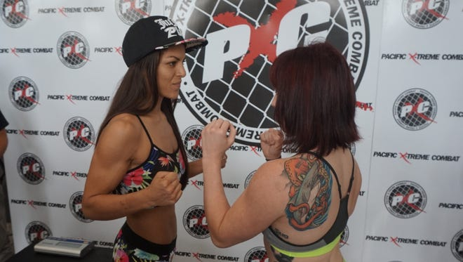 Brogan Walker, left, and Gabby Romero will square off in the main event of Pacific Xtreme Combat 49. They both made weight for the fight during the weigh-in event at Cars Plus Guam in Maite on Thursday, Aug. 6, 2015.