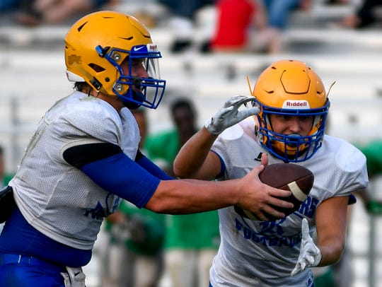 Riverside quarterback Stone Frost (4) hands off the