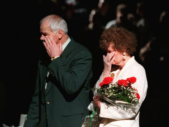 3/10/95-JUDD HEATCOTE LAST BRESLIN GAME--  Jud Heathcote  and his wife Beverly wipe tears from the eyes during post game ceromonies Saturday in honor of Heathcote's last game at Breslin center.(PHOTO BY JULIAN H. GONZALEZ)