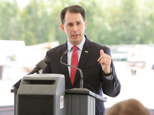 Wisconsin Gov. Scott Walker speaks during MilliporeSigma's announcement of a $64 million, 80,000-square-foot facility Sept. 5 in Sheboygan Falls. MilliporeSigma said the addition to its Sheboygan Falls location is expected to add an additional 175 employees.