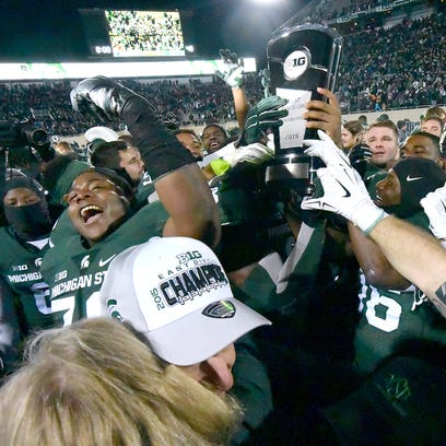 Michigan State Spartans celebrate with the Big Ten