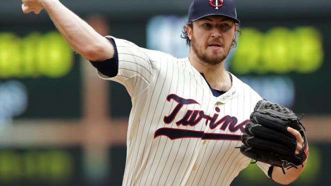 Minnesota Twins pitcher Phil Hughes throws Sept. 24 against the Arizona Diamondbacks in the first inning of a baseball game in Minneapolis. A person familiar with the deal says the Minnesota Twins and Hughes have agreed to a $58 million, five-year contract that adds $42 million in guaranteed money from 2017-19, on Monday, Dec. 22.