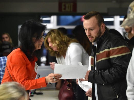 Voters register for the Rebulican caucus at Hug High