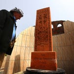 A man checks a memorial to mark the 100th anniversary of the mass killings of Armenians under the Ottoman Empire on April 17 in an Iraqi village.