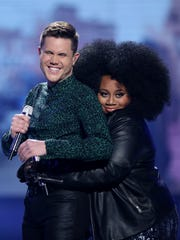 """Trent Harmon, left, and La'Porsha Renae appear at the """"American Idol"""" farewell season finale on Thursday in Los Angeles."""
