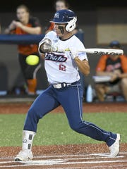 Kelly Kretschman takes a turn at bat during Tuesday's game at Space Coast Stadium.
