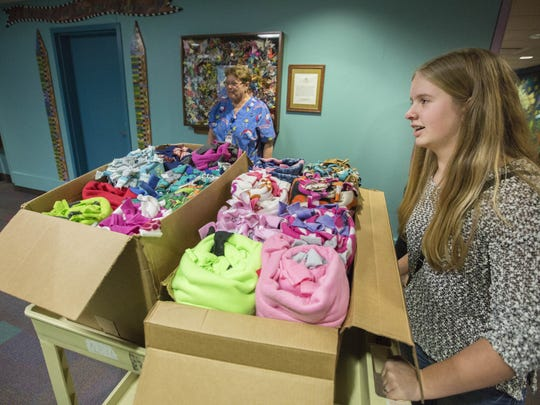 Grace Braun, 14, a freshman at Algona High School makes a Christmas Eve delivery of 50 handmade blankets to Blank Children's Hospital Thursday Dec. 24, 2015.