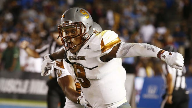 ASU's Kalen Ballage celebrates his rushing touchdown against UCLA in the second half on Oct. 3, 2015 at the Rose Bowl in Pasadena, CA.