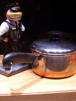 Conductor Herky — a more recent Christmas gift — stands watch over the one-quart sauce pan from an earlier holiday.