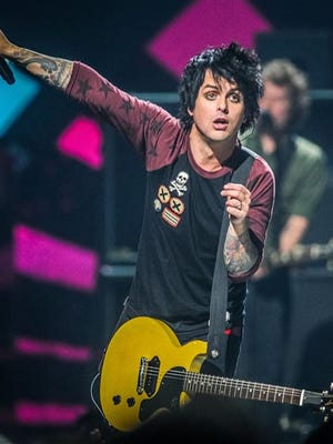 FILE - This Sept. 21, 2012 file photo shows Billie Joe Armstrong of Green Day on stage at the iHeart Radio Music Festival at the MGM Grand Arena in Las Vegas.