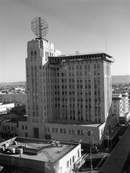 The construction of the Valley National Bank sign atop