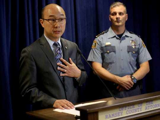 Ramsey County Attorney John Choi speaks at a news conference
