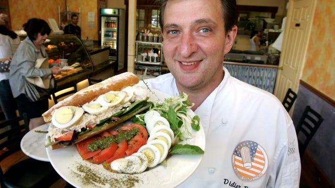 Didier Dumas displays his pan bagnat sandwich at Patisserie Didier Dumas in Nyack
