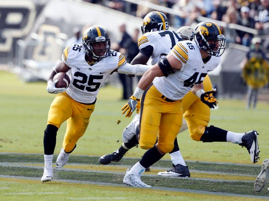 Iowa Hawkeyes running back Adrum Wadley (25) runs with the ball against the Purdue Boilermakers at Ross Ade Stadium.