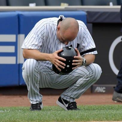 New York Yankees third base coach Joe Espada reacts