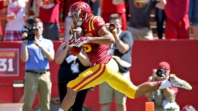 Iowa State's #5 Allen Lazard ran through the end zone after he caught a long pass on trick play to score his team's fourth touchdown against Kansas State during football game at Jack Trice Stadium in Ames on Saturday Sept. 6, 2014.