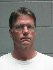 Michael Gerken is charged with first-degree theft and