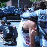 One student was killed and two others were injured after a gunman opened fire before being tackled by a student at Seattle Pacific University on June 5, 2014.