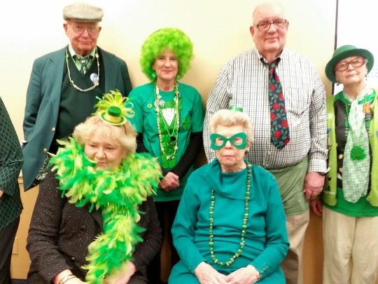 "60 shades of green The Evansville Duplicate Bridge Club's St. Patrick's Day ""party game"" included 15 tables of four players each, and folks made sure to be dressed in their most St. Patty's day attire.  Seated are Jane Perkins and Sandy Altheide.  Standing from left are JoAnne Miley, John Lawler, Pam Schultz, Cal Wade and Karen Nunn."