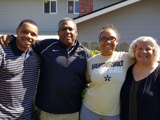 Vanderbilt coach Osia Lewis (second from left) with his family (from left), Marvin, Kiana and wife Darlene.