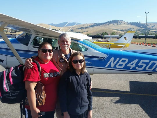 Dr. Reg Goodwin of Helena, center, says Angel Flight West gives him a chance to give back. Photo courtesy of Jared Smith
