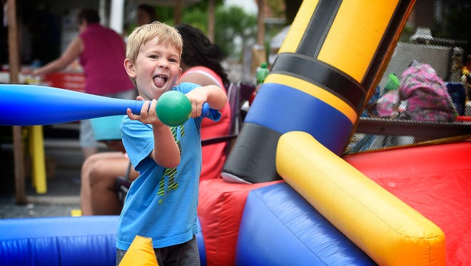 Trevor Yiengst, 4, takes batting practice while attending the WellSpan Good Samaritan Hospital Auxiliary Street Fair Saturday, June 4. The annual fair featured food, games and fun.