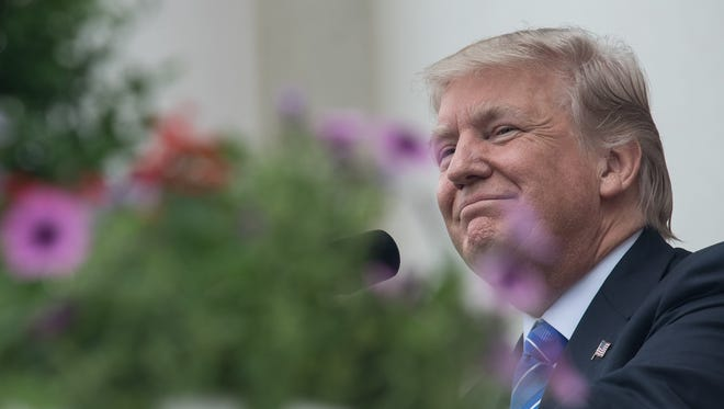 This file photo taken on May 29, 2017 shows US President Donald Trump  at Arlington National Cemetery to mark Memorial Day in Arlington, Virginia.
