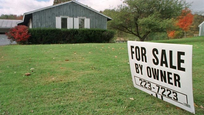 A sign advertises a home for sale in Montpelier.