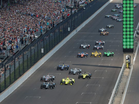 Ed Carpenter (20) leads the group of 33 cars at the start of the102nd running of the Indianapolis 500 at Indianapolis Motor Speedway on Sunday, May 27, 2018.
