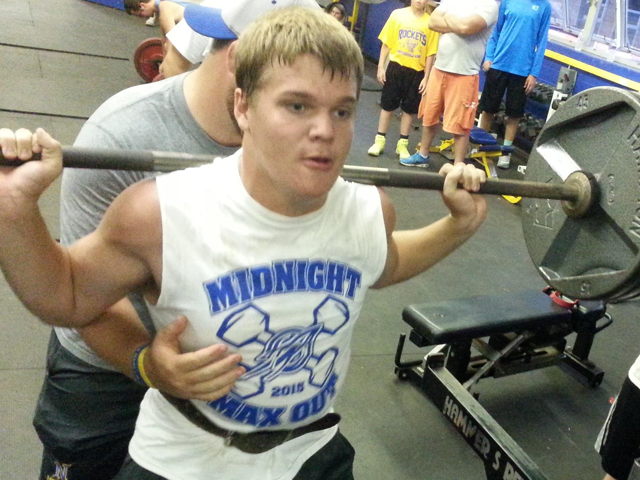 CNE football junior captain Luke Newton lifts during the team's Midnight Maxout.