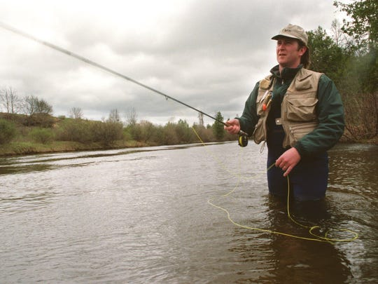 Doug Stanton, practicing on the Boardman River south of Traverse City in 1994.  Photographer: Al Kamuda  Credit: 28 April 1994  Object Name: Fly fisher  Source: Sports