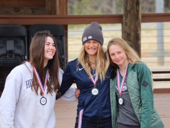 Sage Donnelly, center, is hoping to earn a spot in the 2020 Olympics for kayak.