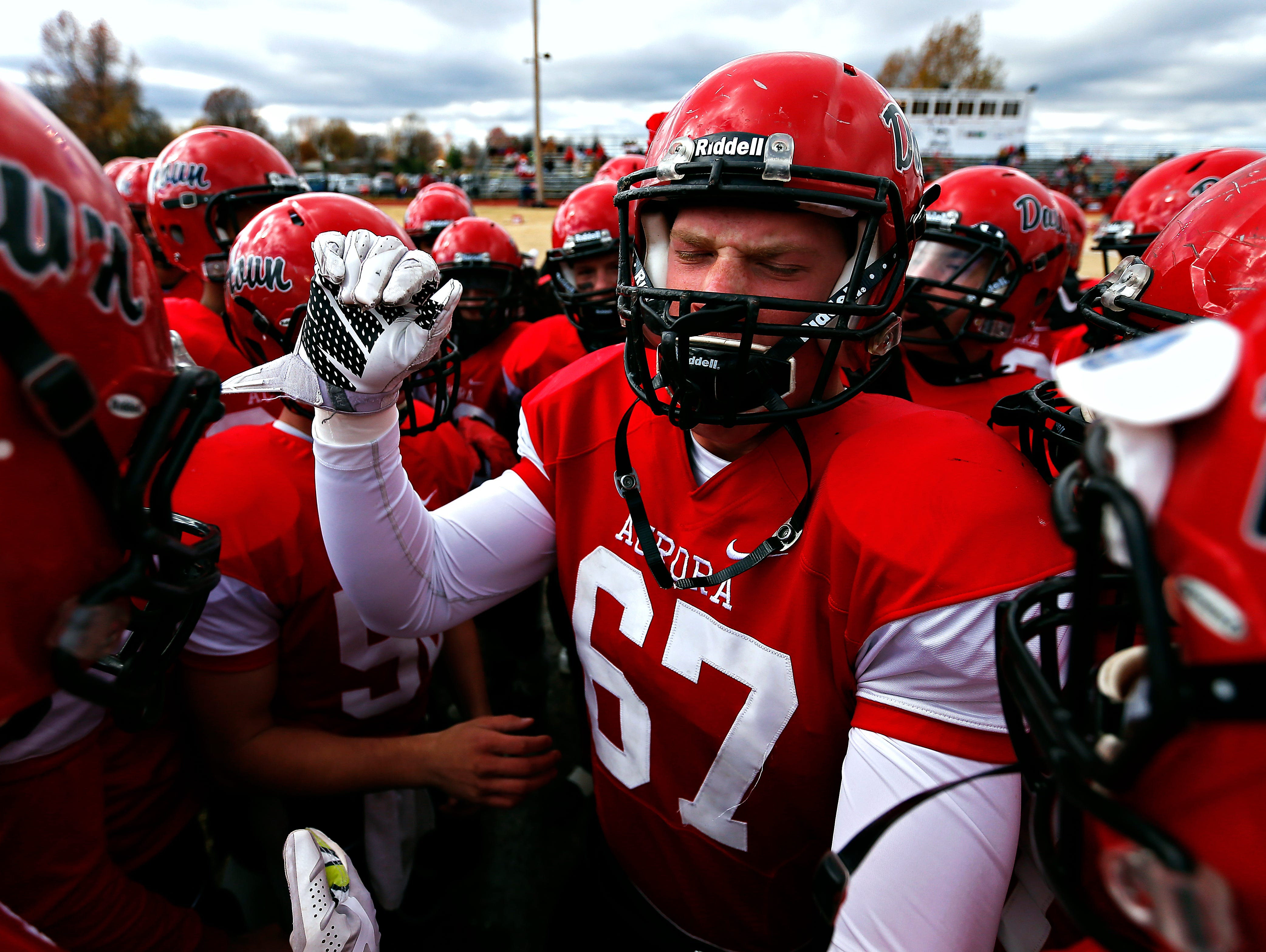 Aurora High School lineman Mason Husmann (67) pumps up his teammates prior to the start of the Houn' Dawgs Class 3 State Semifinal game against Odessa High School at Kelley Field in Aurora, Mo. on Nov. 21, 2015. The Odessa Bulldogs won the game 14-7.