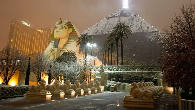 Snow covers the Luxor Resort & Casino on the Las Vegas Strip during a rare snowstorm on Dec. 17, 2008. The National Weather Service has issued a winter weather advisory for Las Vegas for New Year's Eve.