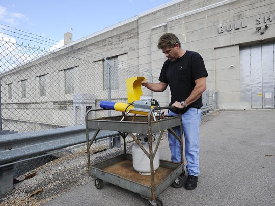 """Joe Raines, senior mechanic at Bull Shoals Dam, prepares to set off a """"scare cannon"""" at the dam in this Dec. 3, 2012 file photograph. After a number of attempts using various methods, the U.S. Army Corps of Engineers is now starting to use lethal methods to deter the birds."""