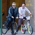 """Bono and Jimmy Fallon tape a spoof of Bono's 2014 bike accident in a skit for """"The Tonight Show"""" May 3 in New York. Bono badly damaged his hand resulting in U2 postponing their tour until this summer"""