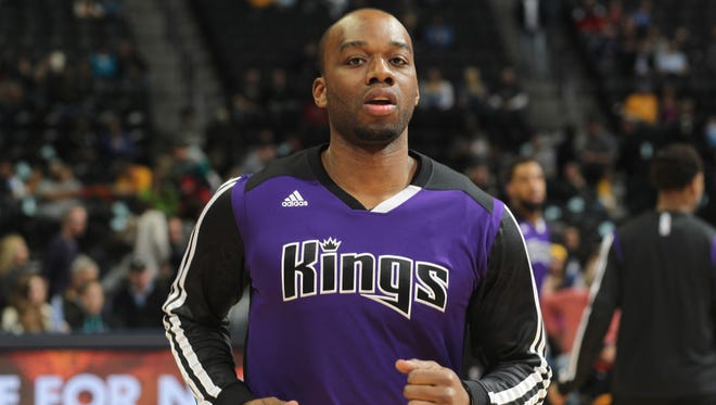 Sacramento Kings forward Carl Landry warms up before facing the Denver Nuggets in the first quarter of an NBA basketball game in Denver on Feb. 23, 2014.
