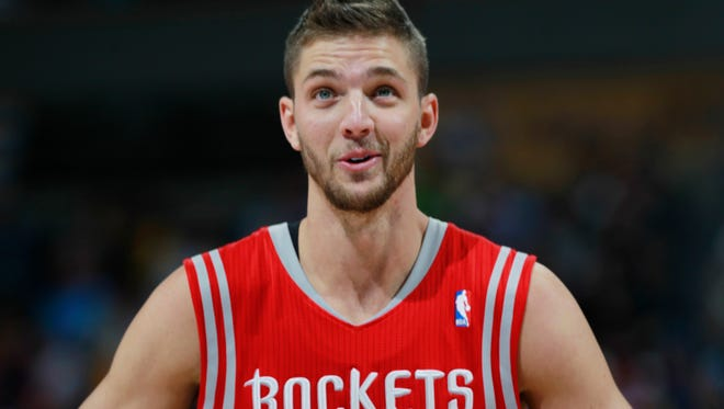 Houston Rockets forward Chandler Parsons looks on against the Denver Nuggets in the third quarter of the Nuggets' 123-116 victory in an NBA basketball game in Denver on Wednesday, April 9, 2014.