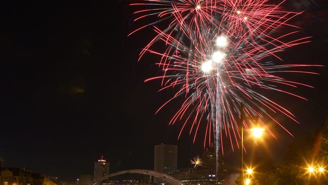 Fourth of July fireworks burst in the air over downtown for the city's celebration in 2014.