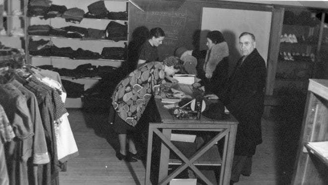 The Clothes Room in December 1938, a SSC project, where clothes were made available to those in need. Located in the old Sheboygan Press building at Seventh Avenue and Center Avenue in Sheboygan.