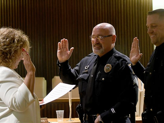 Safety-Service Director Lori Cope swears in Ken Carroll to be a lieutenant, and Matt Loughman to be a sergeant in Jan. 2017.