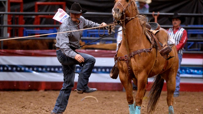 Nolan Conway records a 9.8 second run in the tie down roping event during the Montana Pro Rodeo Circuit Finals earlier this month in the Four Seasons Arena.