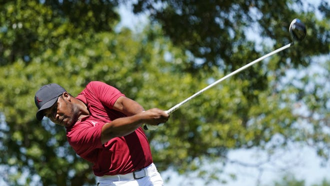 Akron native Harold Varner III tees off on the 14th hole during the first round of the Charles Schwab Challenge at the Colonial Country Club in Fort Worth, Texas, Thursday.